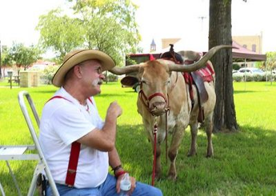 Day 3: Campers take photos with 'Tumbleweed' the Longhorn and learn about the breed's traits and history from handler Ron Sitton.