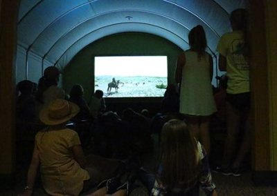 Day 1: Campers watch 'Pointing Them North' — a Chisholm Trail Heritage Museum short film — in the Stars Along The Rawhide Trail Theater.