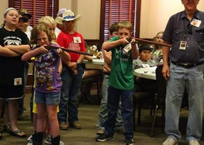 Day 1: Campers participate in a sharpshooting activity and competition with rubber-band rifles.